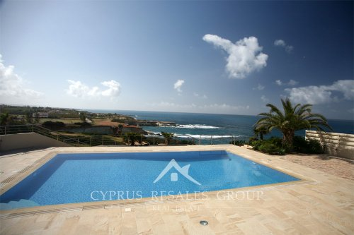 Elevated pool terrace of a sea front exclusive villa in Sea Caves, Cyprus